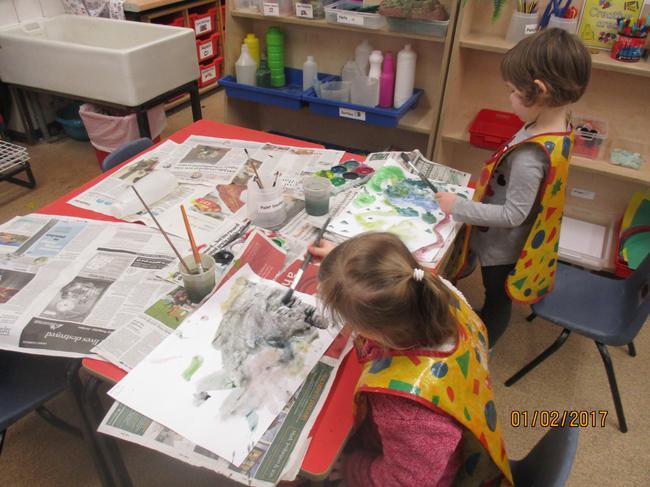We love to paint in Nursery