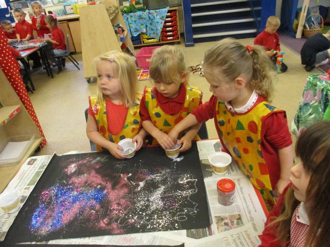Decorating backing paper for our space display!
