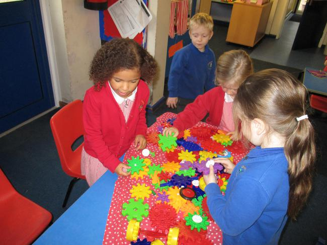Using cogs to make wheels that connect to turn.