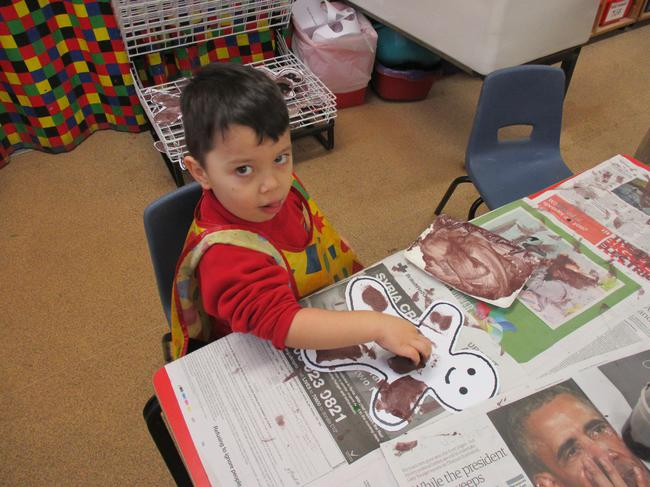 Sponge painting the Gingerbread Man template.