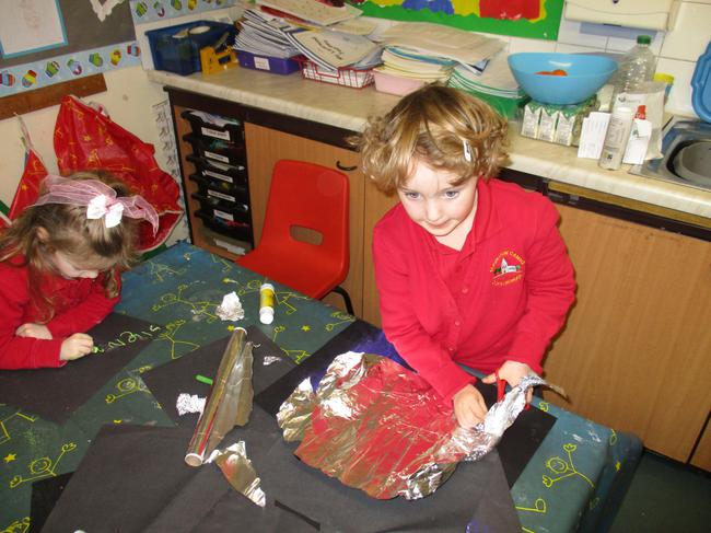 We made shiny, icy pictures.