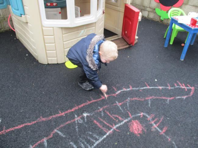 Using the chalk to draw a spider!