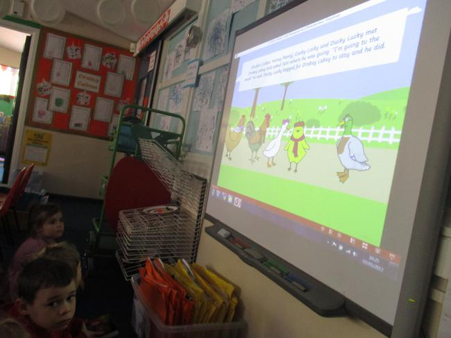 We read 'chicken Licken' on the smartboard
