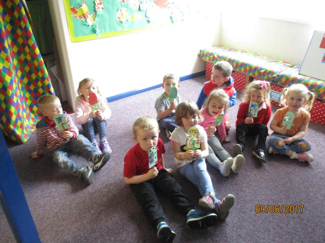Pretending to eat our finished lollipops!