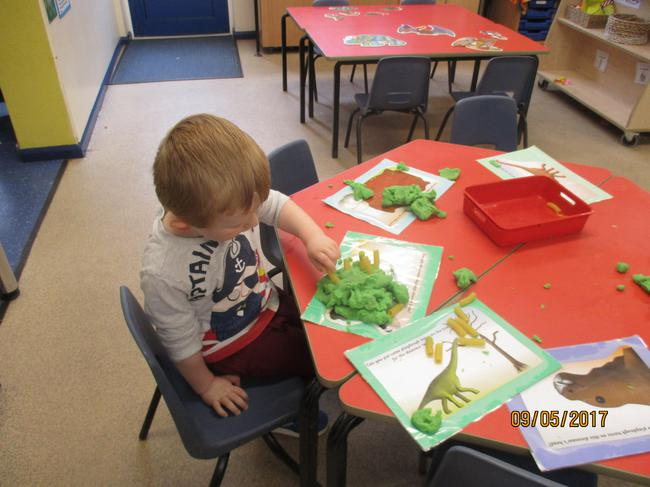 Making dinosaur bones and eggs out of play dough