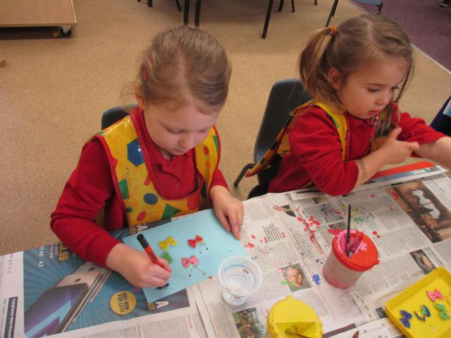 Using pasta and paint to make a butterfly picture!