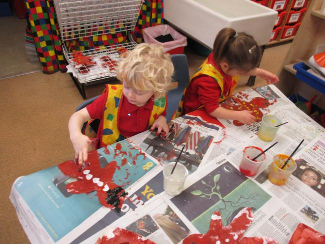 Decorating the Gingerbread man shaped paper!