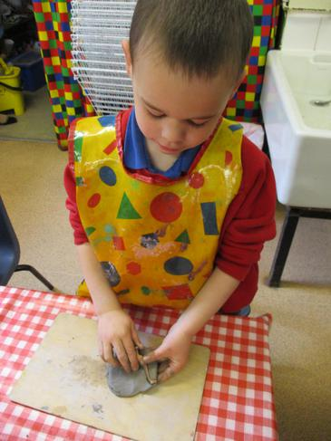 I am using clay to make a dinosaur fossil.