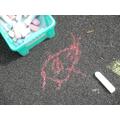 The children drew aliens outside
