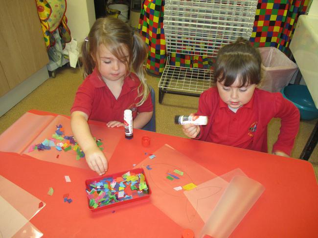 Tissue paper fish - we will laminate them!