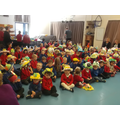 Big School assembly, showing off our bonnets.