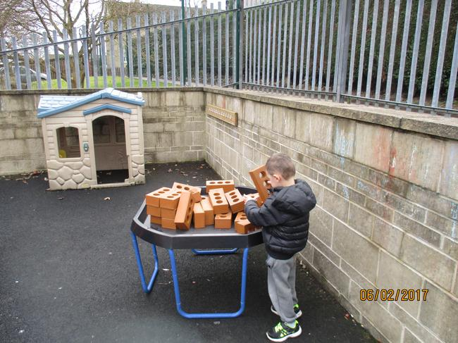 Building with our new bricks outside