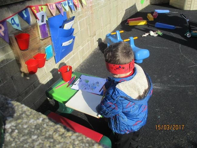 Playing at the outside writing table