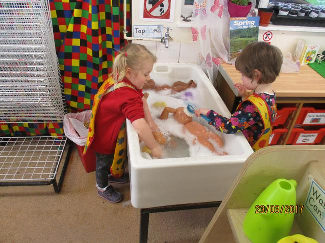 Washing the dollies in the water tray