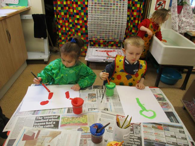 Painting pictures of dinosaurs!