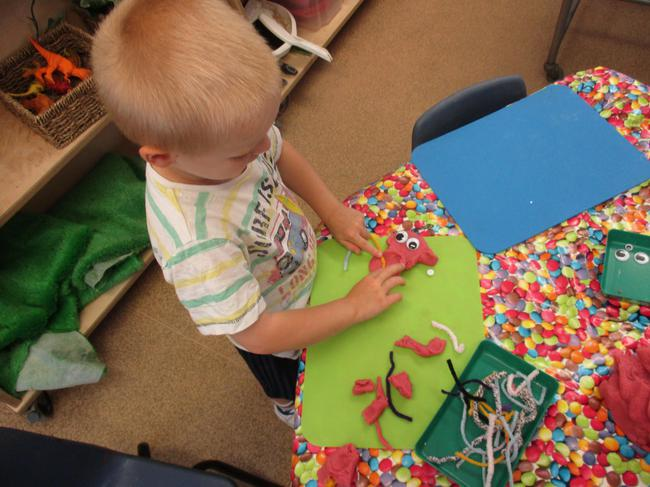 Creating our own aliens with playdough!