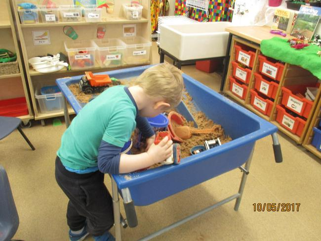 Playing in the sand tray