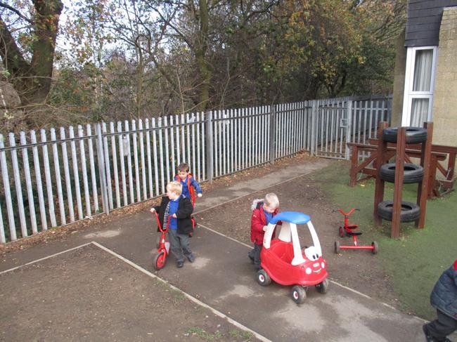 Using wheeled toys outside.