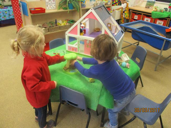 Having fun with Peppa in the dolls house and park.