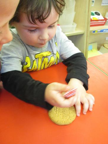 Decorating our biscuits for snack!