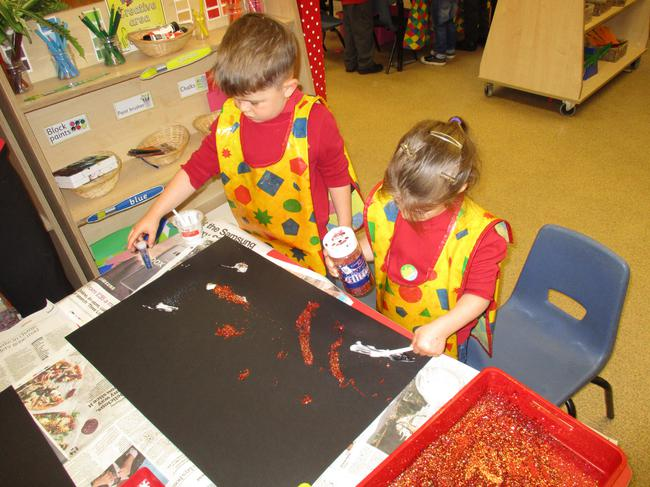 Decorating our display backing paper.