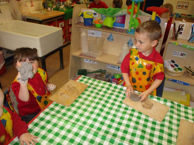 We are using clay to make a dinosaur fossil!