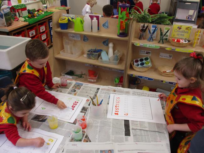 Forming letters with paint!