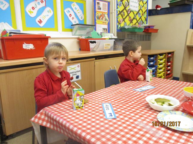 Enjoying some fruit and milk at snack time