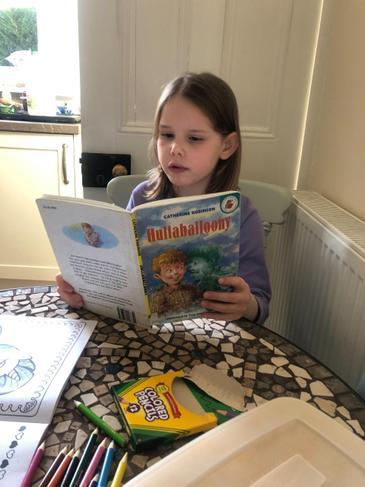 Nicole reading her school book.