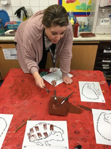 Make a hedgehog picture using brown paint and a fork or even leaves