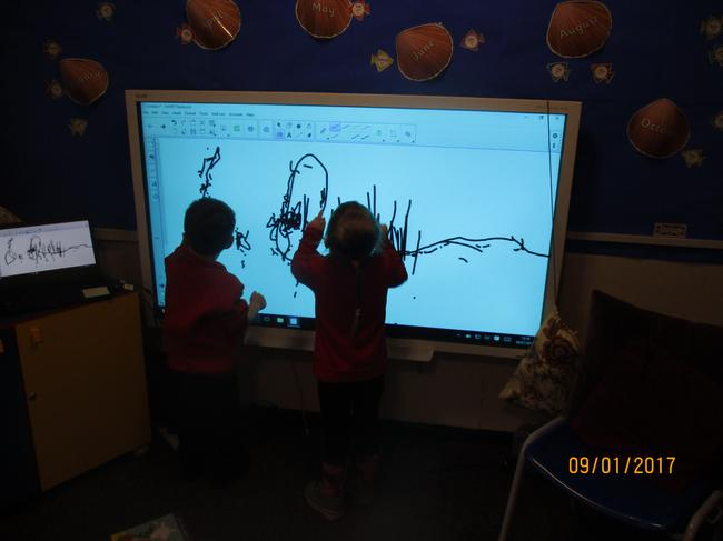 We love drawing pictures on the SMARTboard.