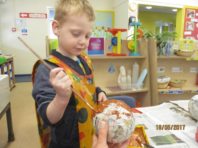 Painting our dinosaur eggs