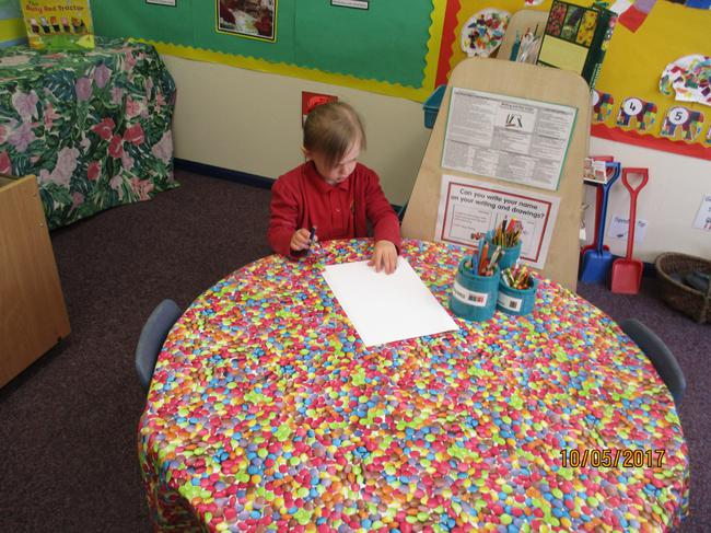 Alana concentrating at the writing table