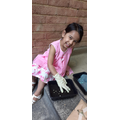 Inaaya planting some seeds!