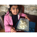 First she slices up the onion
