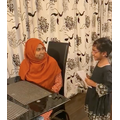 Nuha taking her mum's order