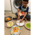 Yasin is carefully cutting fruit
