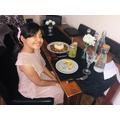 Uzma enjoying her family restaurant