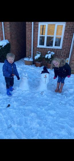 Isabella and her brother and their snow family!