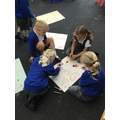 Group-work outdoors practising letter formation