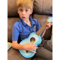 Wow, you're learning to play the ukulele!