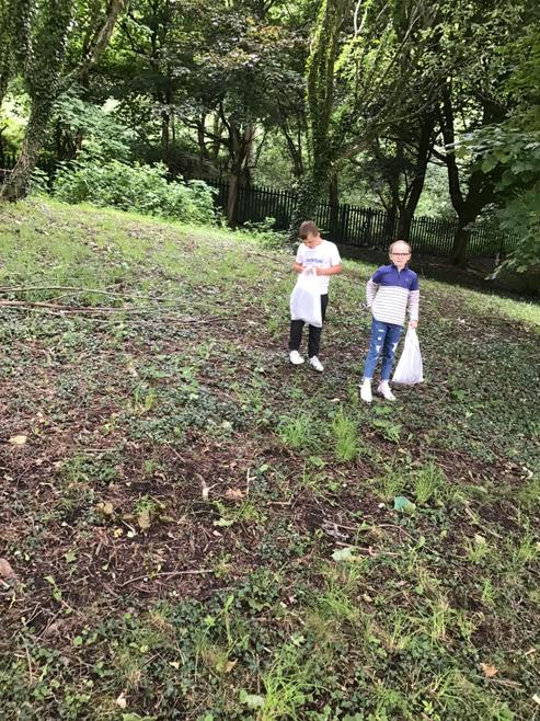 Carys & Mason collecting twigs