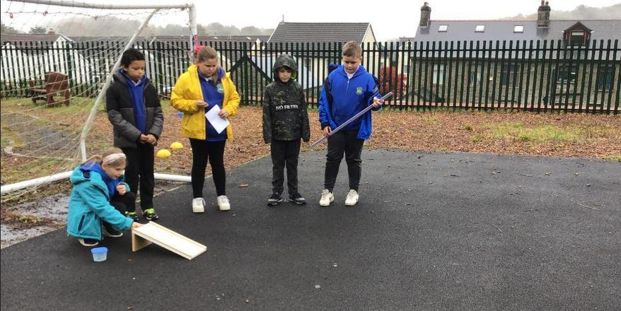 Does the type of surface affect how far a cannon ball will travel?