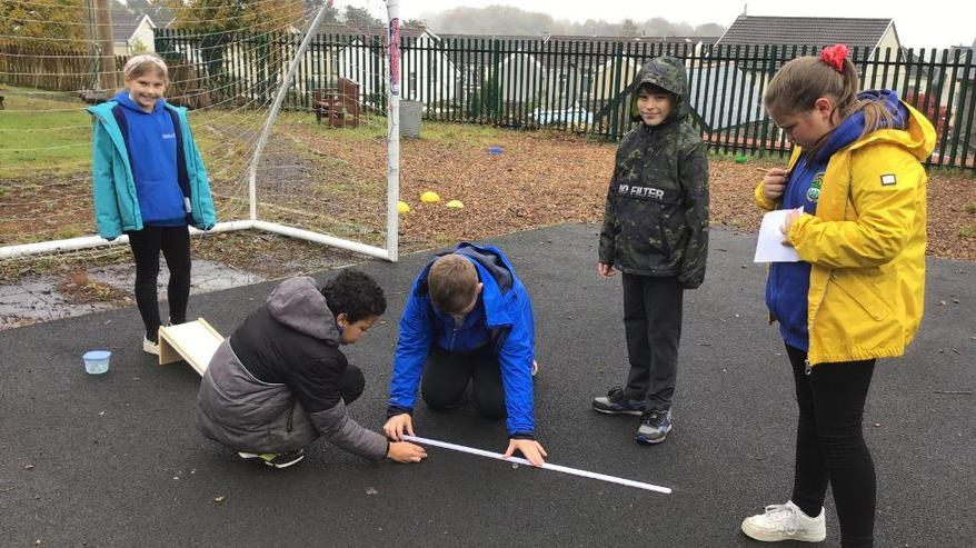We tested different surfaces and measured how far it went.