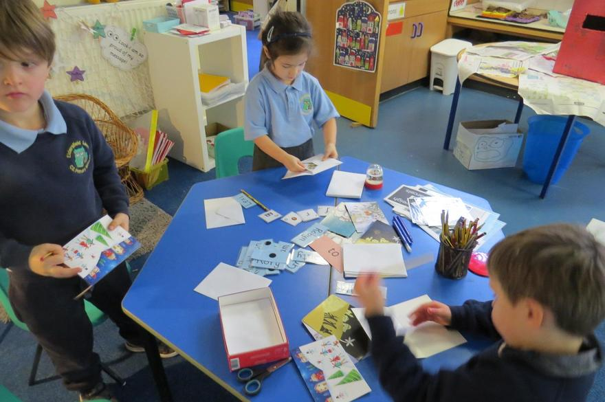 writing Christmas cards to our friends..