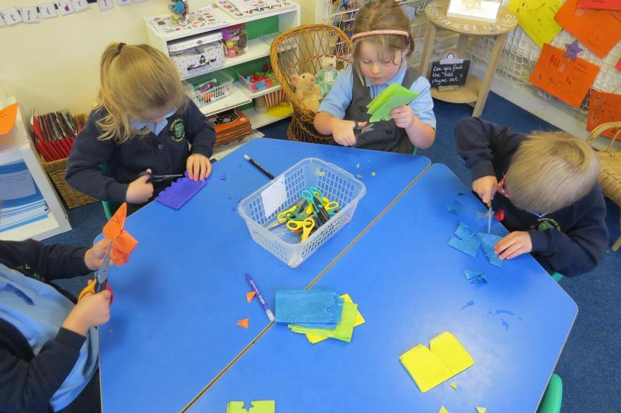 Using our cutting skills for folded paper bunting