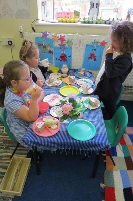 Sharing in the home corner, ready for Granny's tea party.