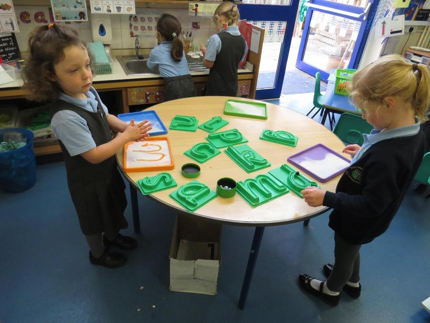 We keep practising our letter formation..