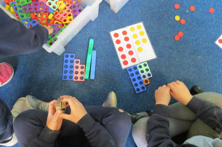 using Numicon, tens frames...