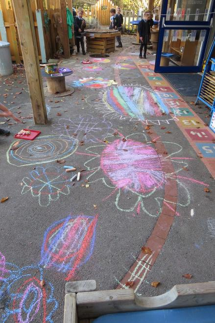 ..and brightly coloured chalks outdoors.